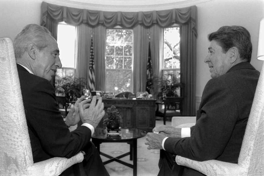 WASHINGTON,  DC: (FILE PHOTO) US President Ronald Reagan (R) meets Israeli Prime Minister Shimon Peres in the White House September 15, 1986 in Washington, DC. Reagan, the nation's longest living president, battled Alzheimer's disease for the past decade and passed away age 93, June 5, 2004 at his home in Bel Air, California. (Photo by Ya'akov Saar/GPO via Getty Images) Photo: Getty Images / Getty Images
