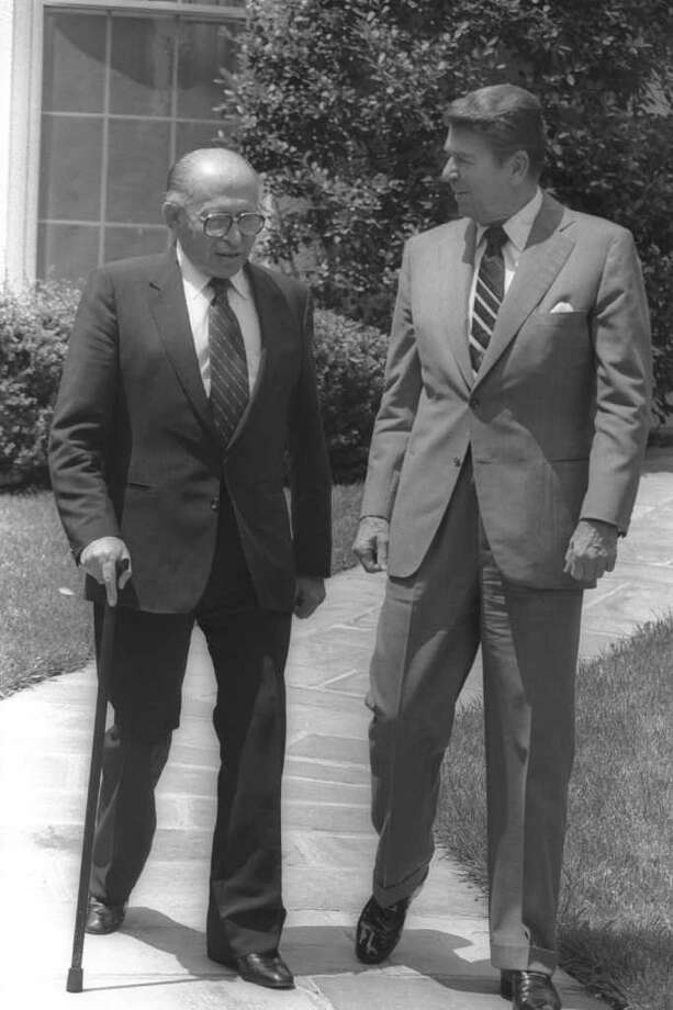 WASHINGTON, DC - JUNE 21: (FILE PHOTO) US President Ronald Reagan (R) and Israeli Prime Minister Menahem Begin walk in the White House gardens June 21, 1982 in Washington, DC. Reagan, the nation's longest living president, battled Alzheimer's disease for the past decade and passed away age 93, June 5, 2004 at his home in Bel Air, California.  (Photo by Ya'akov Saar/GPO via Getty Images) Photo: Getty Images / Getty Images