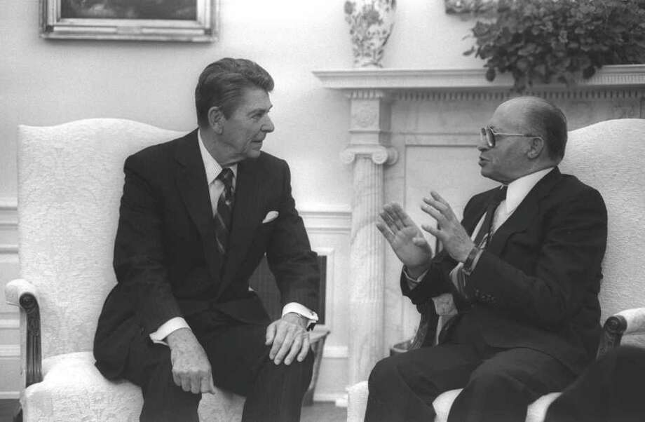 WASHINGTON, DC: (FILE PHOTO) US President Ronald Reagan (L) and Israeli Prime Minister Menahem Begin meet in the White House September 9, 1981 in Washington, DC. Reagan, the nation's longest living president, battled Alzheimer's disease for the past decade and passed away age 93, June 5, 2004 at his home in Bel Air, California. (Photo by Ya'akov Saar/GPO via Getty Images) Photo: Getty Images / Getty Images