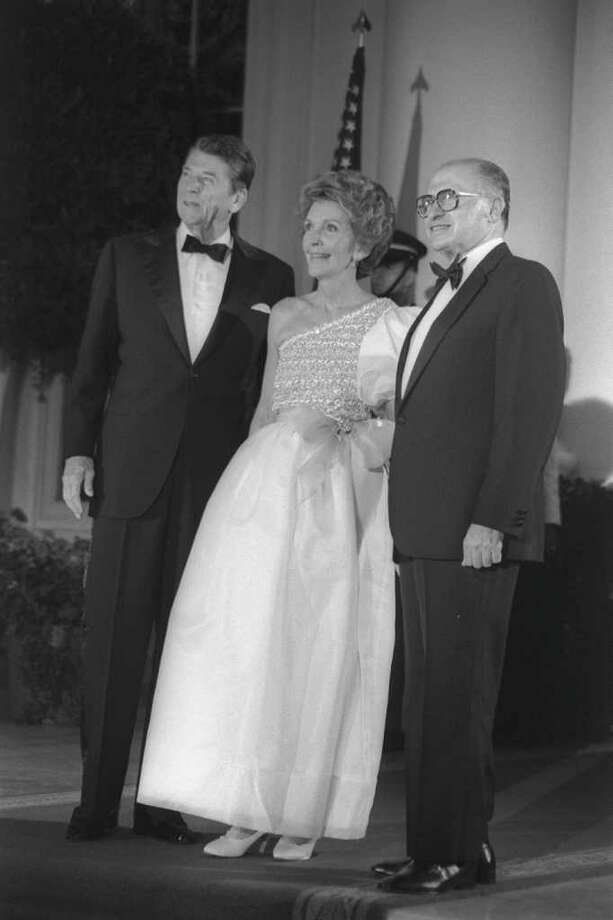 WASHINGTON D.C., USA: (FILE PHOTO) US President Ronald Reagan (L) poses with his wife Nancy Reagan and Israeli Prime Minister Menahem Begin during an gala dinner at the White House September 9, 1981 in Washington, DC. Reagan, the nation's longest living president, battled Alzheimer's disease for the past decade and passed away age 93, June 5, 2004 at his home in Bel Air, California. (Photo by Ya'akov Saar/GPO via Getty Images) Photo: Getty Images / Getty Images