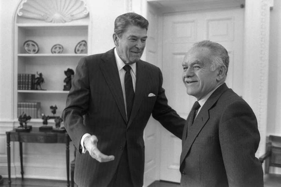 WASHINGTON D.C., USA: (FILE PHOTO) US President Ronald Reagan (L) and Israeli Prime Minister Yitzhak Shamir meet in the White House February 18, 1987 in Washington, DC. Reagan, the nation's longest living president, battled Alzheimer's disease for the past decade and passed away age 93, June 5, 2004 at his home in Bel Air, California.  (Photo by Herman Chanania/GPO via Getty Images) Photo: Getty Images / Getty Images