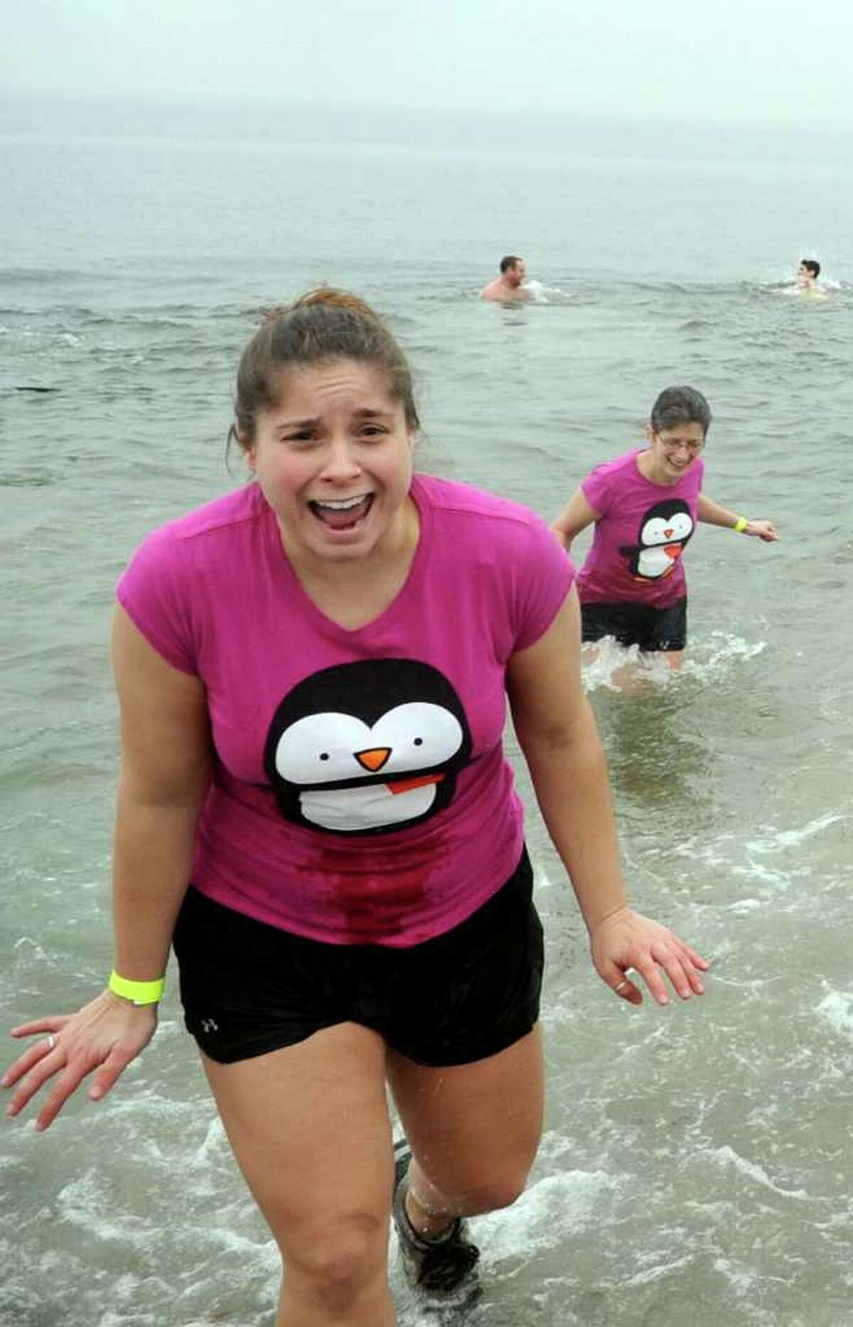 Laura Magnotta, of Fairfield, runs out of the Long Island Sound during the Burroughs Community Center's fourth annual Freezin' for a Reason plunge Saturday, Feb. 5, 2011 at Jennings Beach in Fairfield.