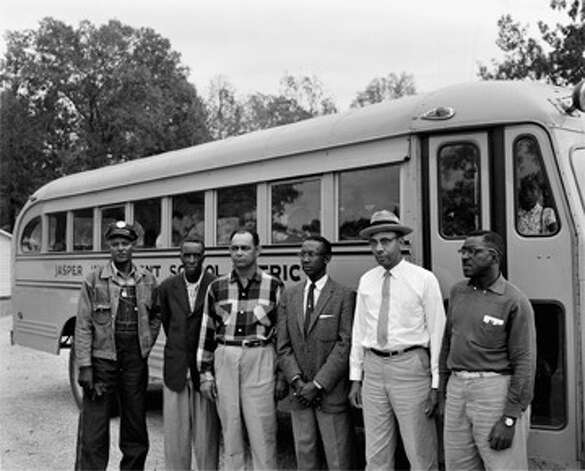 Alonzo Jordan [Men in front of school bus, Jasper, Texas], October 29, 1959 © 1996 Documentary Arts, Inc. Photo: Provided / Beaumont