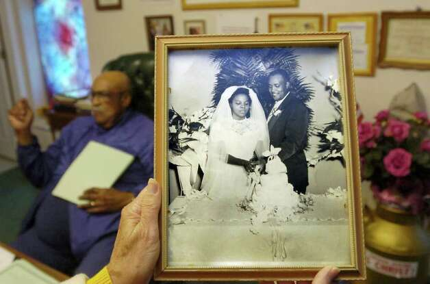 Photographer Alonzo Jordan photographed the Reverend John D. Hardin's wedding.  He still keeps the photograph on a shelf in his office.   Dave Ryan/The Enterprise Photo: Dave Ryan / Beaumont