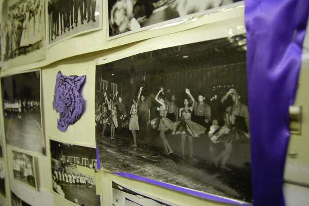 In a room at the Lonestar Youth Council Community Center, dedicated to the memories of the J. H. Rowe High School Tigers, a collection of photographs, many taken by community photographer Alonzo Jordan, like this one of a dance, are taped together as keepsakes.  Dave Ryan/The Enterprise Photo: Dave Ryan / Beaumont