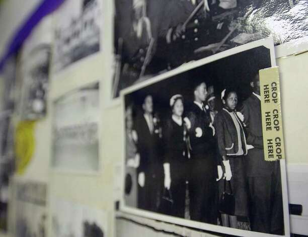 In a room at the Lonestar Youth Council Community Center, dedicated to the memories of the J. H. Rowe High School Tigers, a collection of photographs, many taken by community photographer Alonzo Jordan, and still show where he planned to do some cropping, are taped together as keepsakes.  Dave Ryan/The Enterprise Photo: Dave Ryan / Beaumont