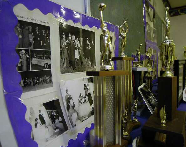 In a room at the Lonestar Youth Council Community Center, dedicated to the memories of the J. H. Rowe High School Tigers, a collection of photographs, many taken by community photographer Alonzo Jordan,  are taped together as keepsakes.  Dave Ryan/The Enterprise Photo: Dave Ryan / Beaumont