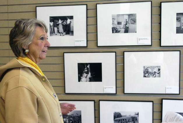 Jasper County Historical Museum Director Nina Messersmith, walks past part of the exhibit of community photographer and barber Alonzo Jordan's work while talking about the different events he photographed. Jordan was based in Jasper, but he also photographed events in the neighboring communities in East Texas.   Dave Ryan/The Enterprise Photo: Dave Ryan / Beaumont
