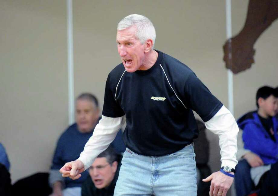 Brunswick School wrestling coach Tim Ostrye in action during the Brunswick School vs. Chase Collegiate of Waterbury, Conn., at Brunswick School, Greenwich, Saturday afternoon, Feb. 5, 2011. Photo: Bob Luckey / Greenwich Time