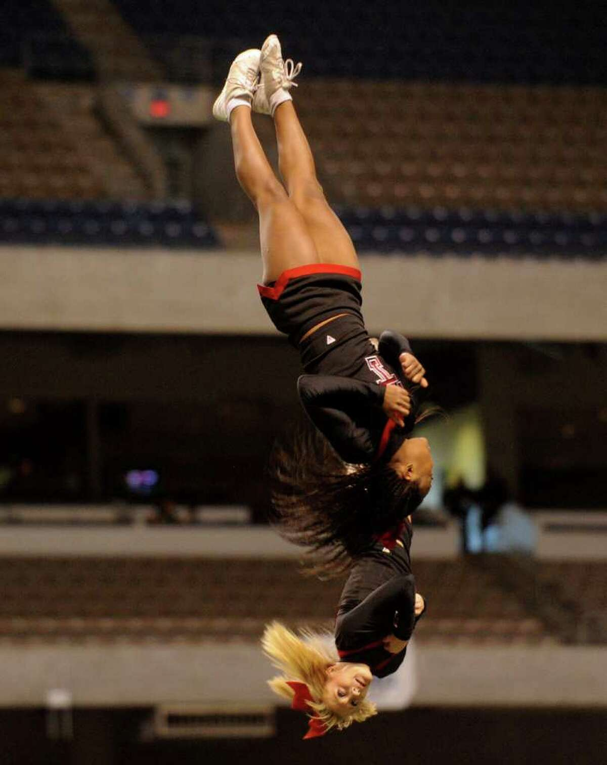 Texas Tech cheerleaders perform during hafltime of the NFLPA Game at the Alamodome on Saturday, Feb. 5, 2011. The game highlights college players hoping for a career in the NFL. BILLY CALZADA / gcalzada@express-news.net Texas versus the Nation