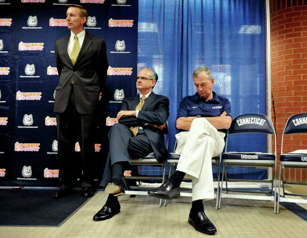 Connecticut basketball head coach Jim Calhoun, right, Director of Athletics Jeff Hathaway, center, and Rick Evrard, the University's outside counsel for NCAA-related matters, right, listen at a news conference in Storrs, Conn., Friday, May 28, 2010. The University says the NCAA has found eight violations in the school's men's NCAA college basketball program. (AP Photo/Jessica Hill)