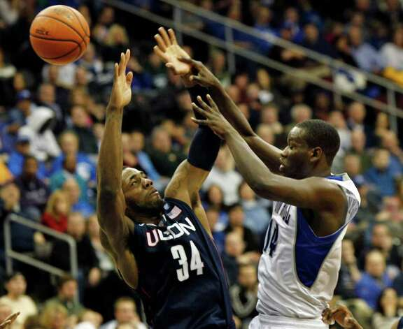 Seton Hall's Eniel Polynice (14) gets off a pass as Connecticut's Alex Oriakhi (34) tries to block during the first half of an NCAA college basketball game Saturday, Feb. 5, 2011, in Newark, N.J. (AP Photo/Mel Evans) Photo: AP