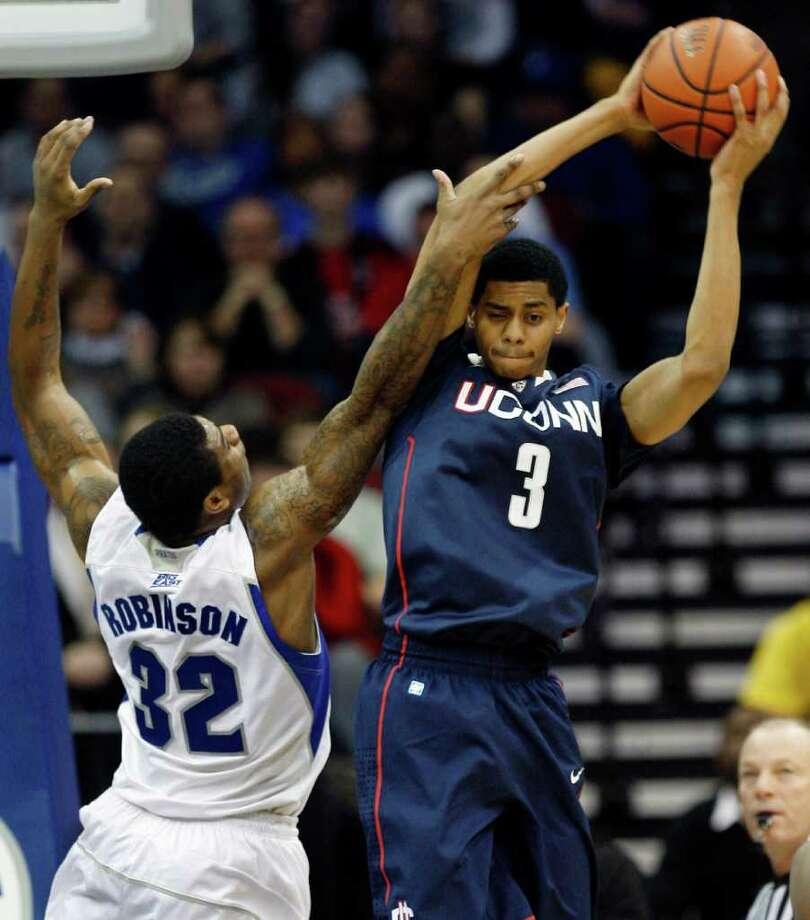 Seton Hall's Jeff Robinson (32) tries to block the path of Connecticut's Jeremy Lamb (3) during the first half of an NCAA college basketball game Saturday, Feb. 5, 2011, in Newark, NJ  (AP Photo/Mel Evans) Photo: AP