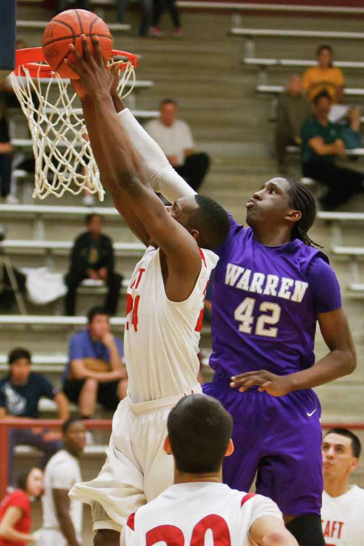 Warren's Taurean Prince-Waller (right) battles Taft's Deondre Logan at the rim during the fourth quarter of their game at the O'Connor Gym on Feb. 5, 2010. Logan led all scorers with 28 points to help the Raiders come away with a hard fought 61-55 victory. MARVIN PFEIFFER/mpfeiffer@express-news.net