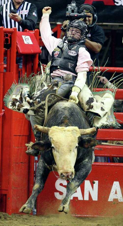 FOR METRO - Will Farrell , from Thermopolis, WY , competes in the Bull Riding event Saturday Feb. 5, 2011 during the San Antonio Stock Show & Rodeo at the AT&T Center. Farrell  was thrown off his bull. (PHOTO BY EDWARD A. ORNELAS/eaornelas@express-news.net) Photo: EDWARD A. ORNELAS, SAN ANTONIO EXPRESS-NEWS / eaornelas@express-news.net
