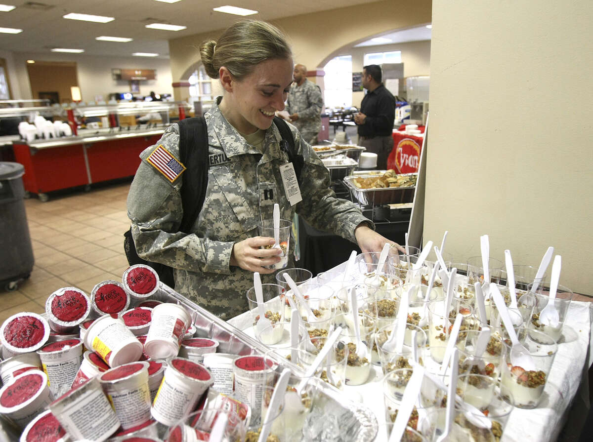 Capt. Shiela Lavertue, a dietitian at Fort Sam Houston, samples a yogurt parfait that's part of an effort to get soldiers to eat better.