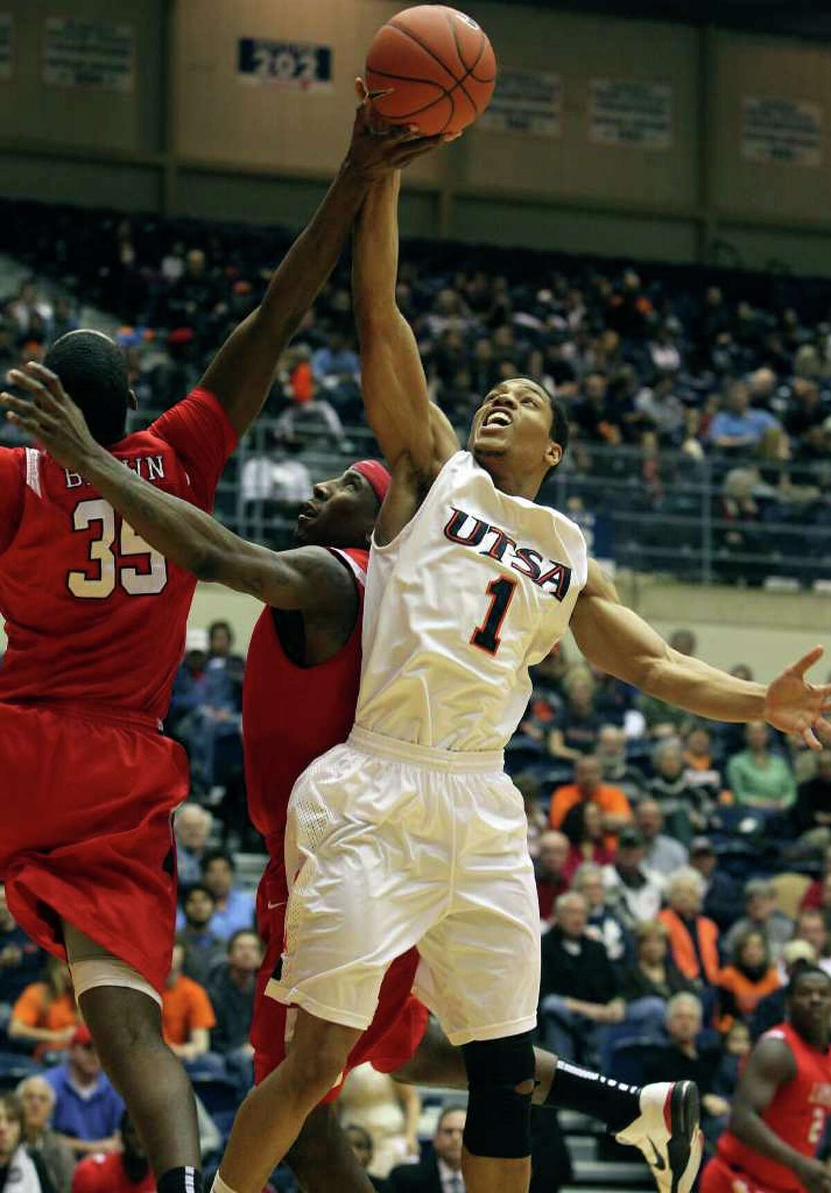 SPORTS Stephen Franklin grabs an offensive rebound in the first half as UTSA plays Lamar in mens' basketball at the UTSA Convocation Center on February 5, 2011. Tom Reel/Staff