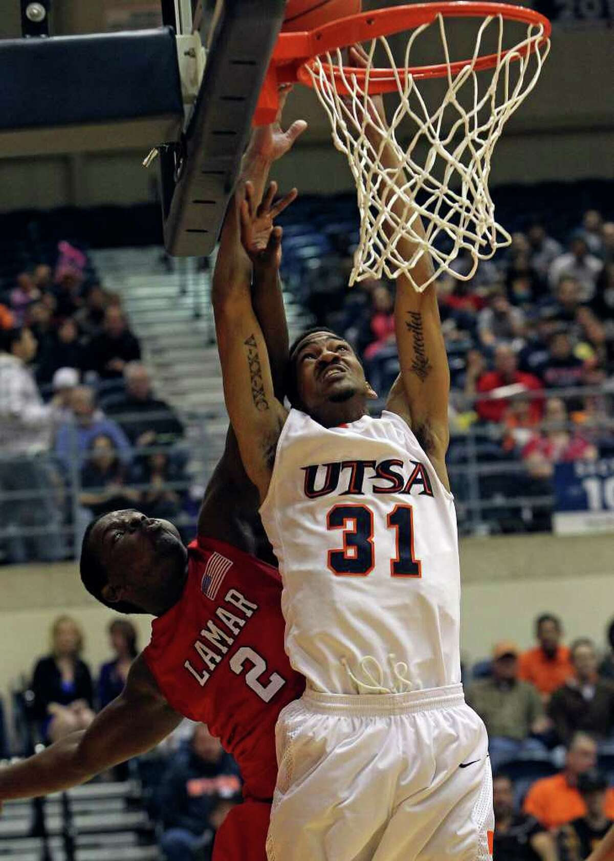 SPORTS Roadrunner forward Melvin Johnson gets the and one bucket against Tremell Adams as UTSA plays Lamar in mens' basketball at the UTSA Convocation Center on February 5, 2011. Tom Reel/Staff