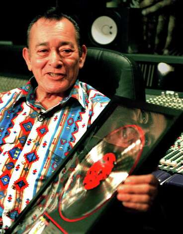 Flaco Jimenez holds a platinum record at Studio M on Sept. 5, 1999, in San Antonio.  The record was presented to Jimenez by Virgin Records for his work on the Rolling Stones Album 'Voodoo Lounge.' Photo: Robert McLeroy / Express-News