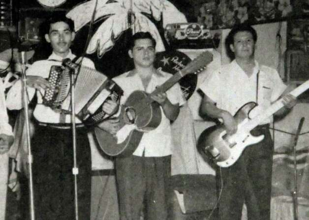 A photo of Flaco Jimenez (from left), Toby Torres and Henry Zimmerle when they were part of the group, Los Caminantes, during the late 1950s. Photo: KIN MAN HUI / San Antonio Express-News