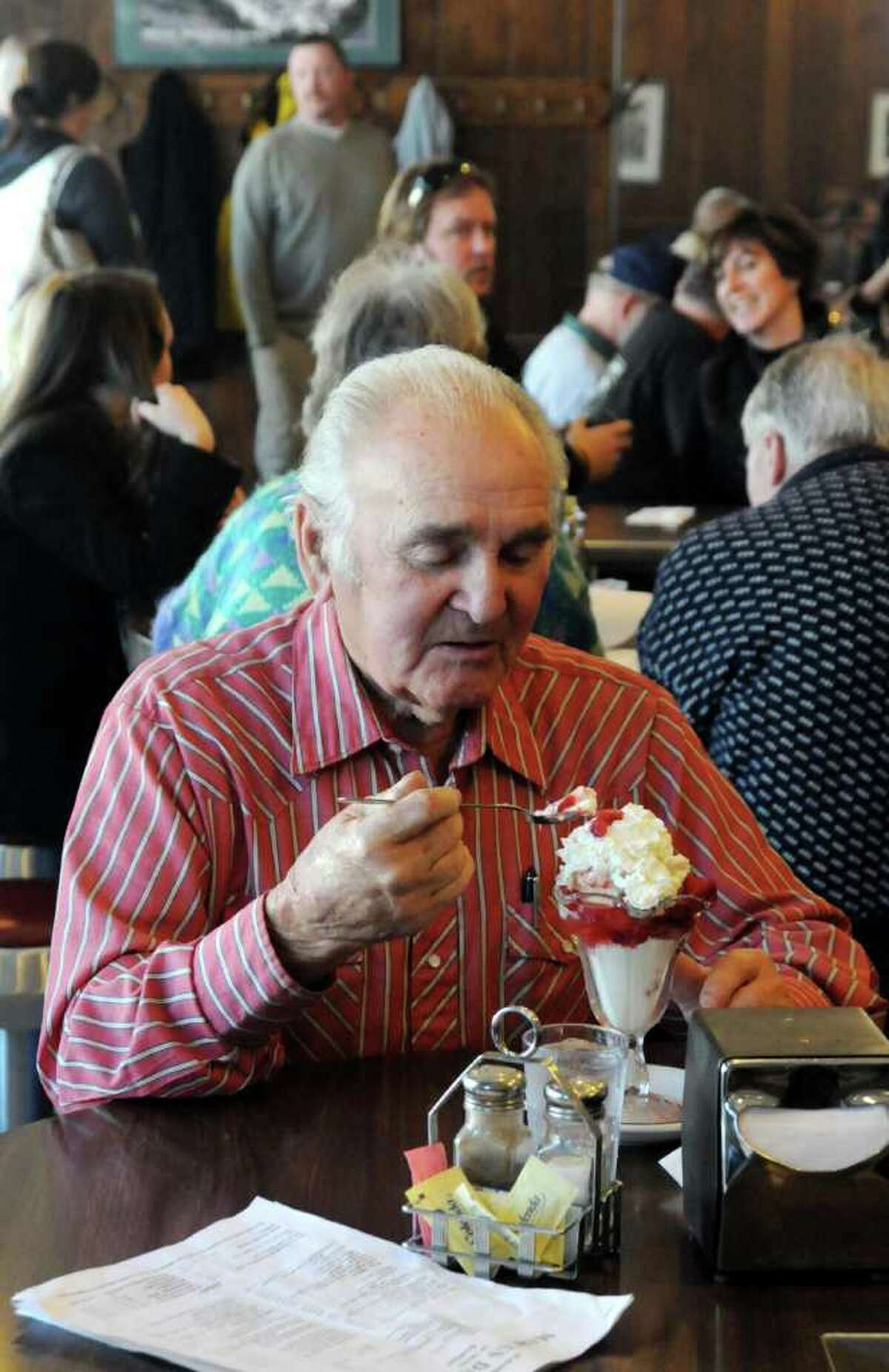 Bob Therrien, 87, of Georgetown enjoys one last strawberry sundae at Marcus Dairy on Sunday Feb. 6, 2011. Therrien has been a patron of Marcus Dairy for 80 years. Sunday was Marcus Dairy's last day of business before closing it's doors.