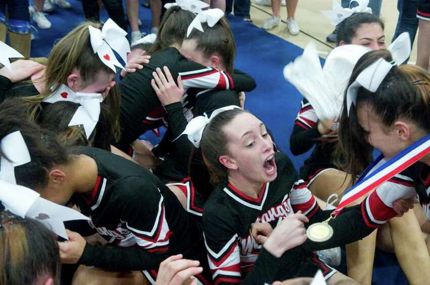 Fairfield Warde High School cheerleaders react to the announcement that they won the FCIAC Cheerleading Championships in Wilton, Conn., Sunday February 6, 2011.