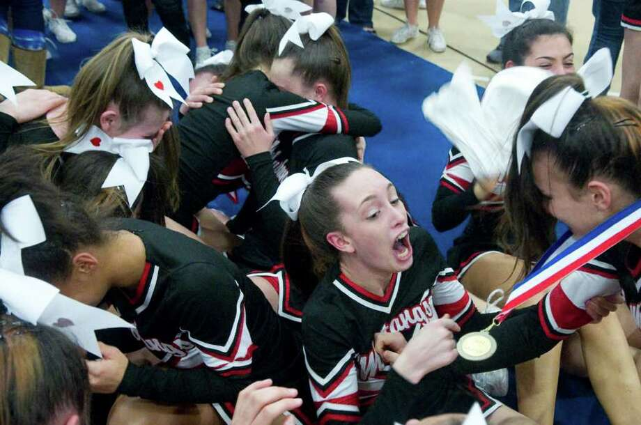 Fairfield Warde High School cheerleaders react to the announcement that they won the FCIAC Cheerleading Championships in Wilton, Conn., Sunday February 6, 2011. Photo: Keelin Daly / Stamford Advocate