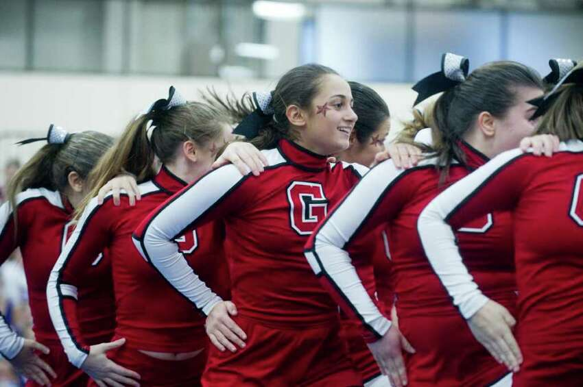 Greenwich High School's Julia DeVico competes in the FCIAC Cheerleading Championships in Wilton, Conn., Sunday February 6, 2011. Greenwich finished second to Fairfield Warde.