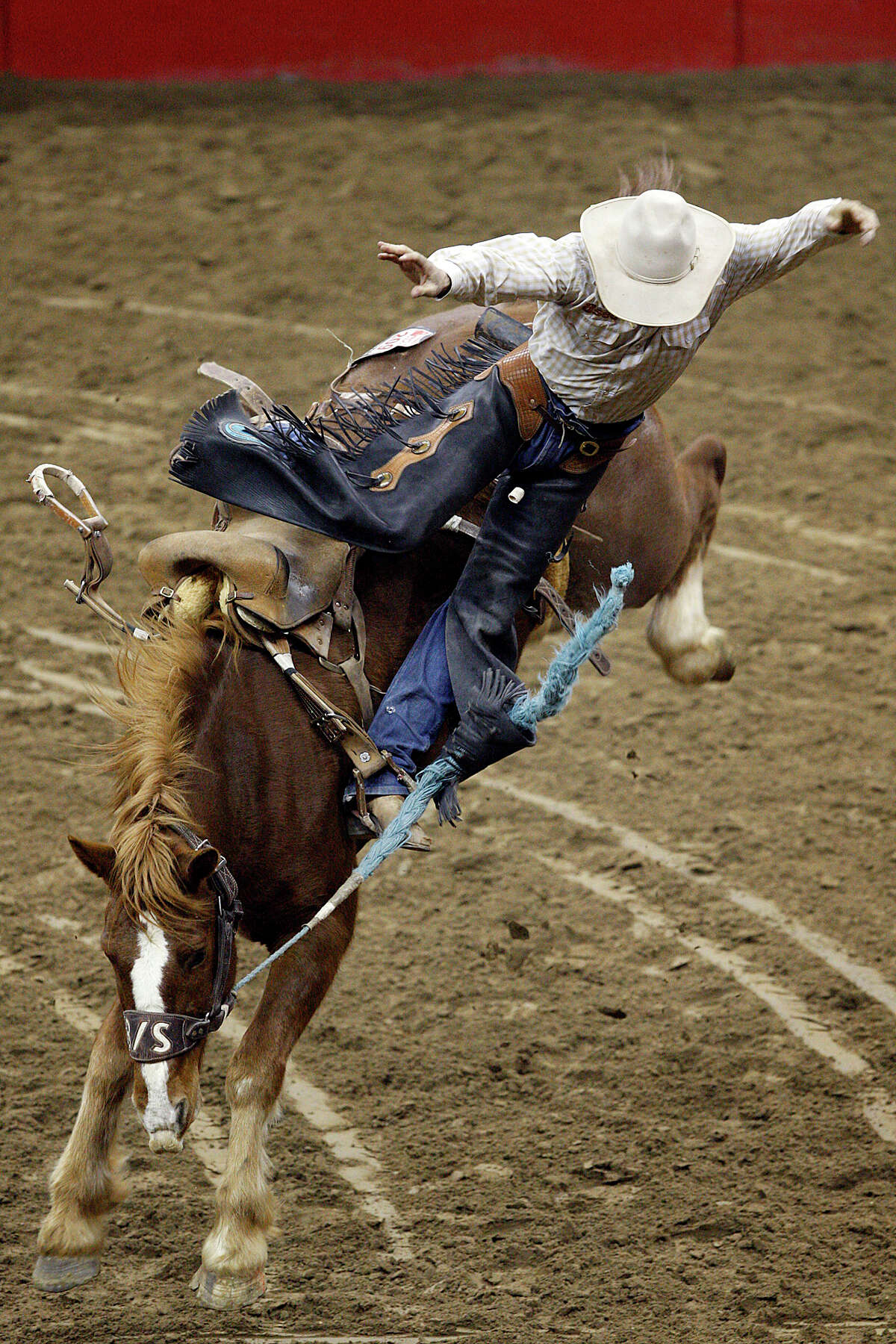Saddle bronc rider Jace Garrett, of Alliance, NE, jumps off during competition at the San Antonio Stock Show and Rodeo, Sunday, Feb. 6, 2011.