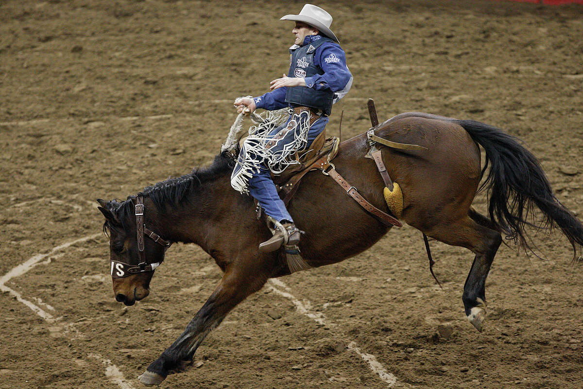 Billy Etbauer, of Edmond, OK, holds on during the saddle bronc riding event at the San Antonio Stock Show and Rodeo, Sunday, Feb. 6, 2011.