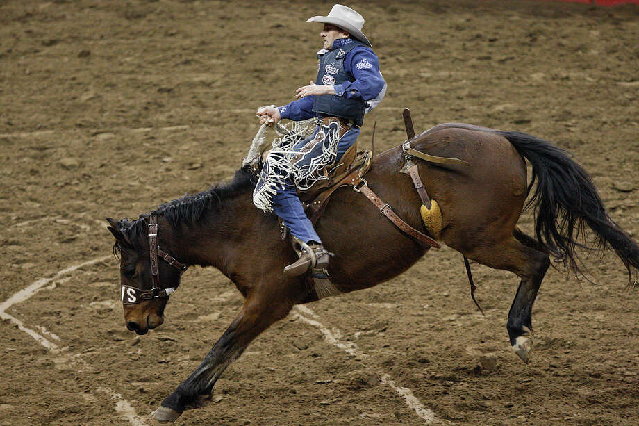 Billy Etbauer, of Edmond, OK, holds on during the saddle bronc riding event at the San Antonio Stock Show and Rodeo, Sunday, Feb. 6, 2011. Photo: Jerry Lara/glara@express-news.net