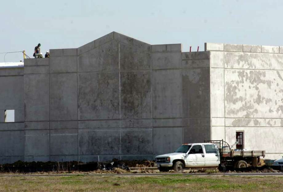 Workers construct a municipal solid waste transfer station at the Port Arthur Business Park in February 2007. Enterprise file photo