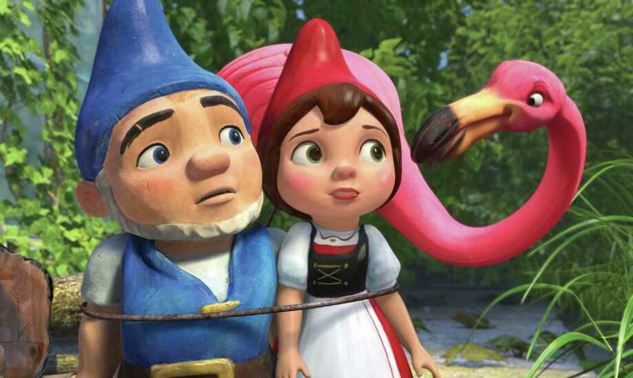 """In this film publicity image released by Touchstone Pictures, Gnomeo, voiced by James McAvoy, left, and Juliet, voiced by Emily Blunt, center, and Featherstone, voiced by Jim Cummings, are shown in a scene from """"Gnomeo and Juliet."""" (AP Photo/Touchstone Pictures) Photo: Anonymous, HO"""
