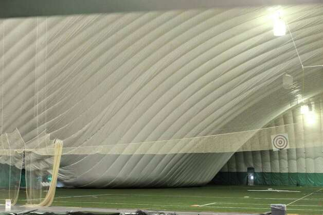 A portion of the roofs sits on the floor of the Adirondack Sports Complex in Queensbury February 7, 2011 after part of the inflated dome collapsed.    (Skip Dickstein / Times Union) Photo: SKIP DICKSTEIN / 10011995A
