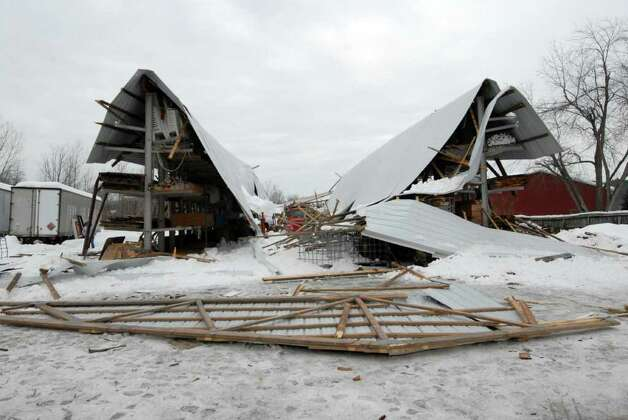 Contractors busy as heavy snow threatens roofs times union for Snow loads on roofs