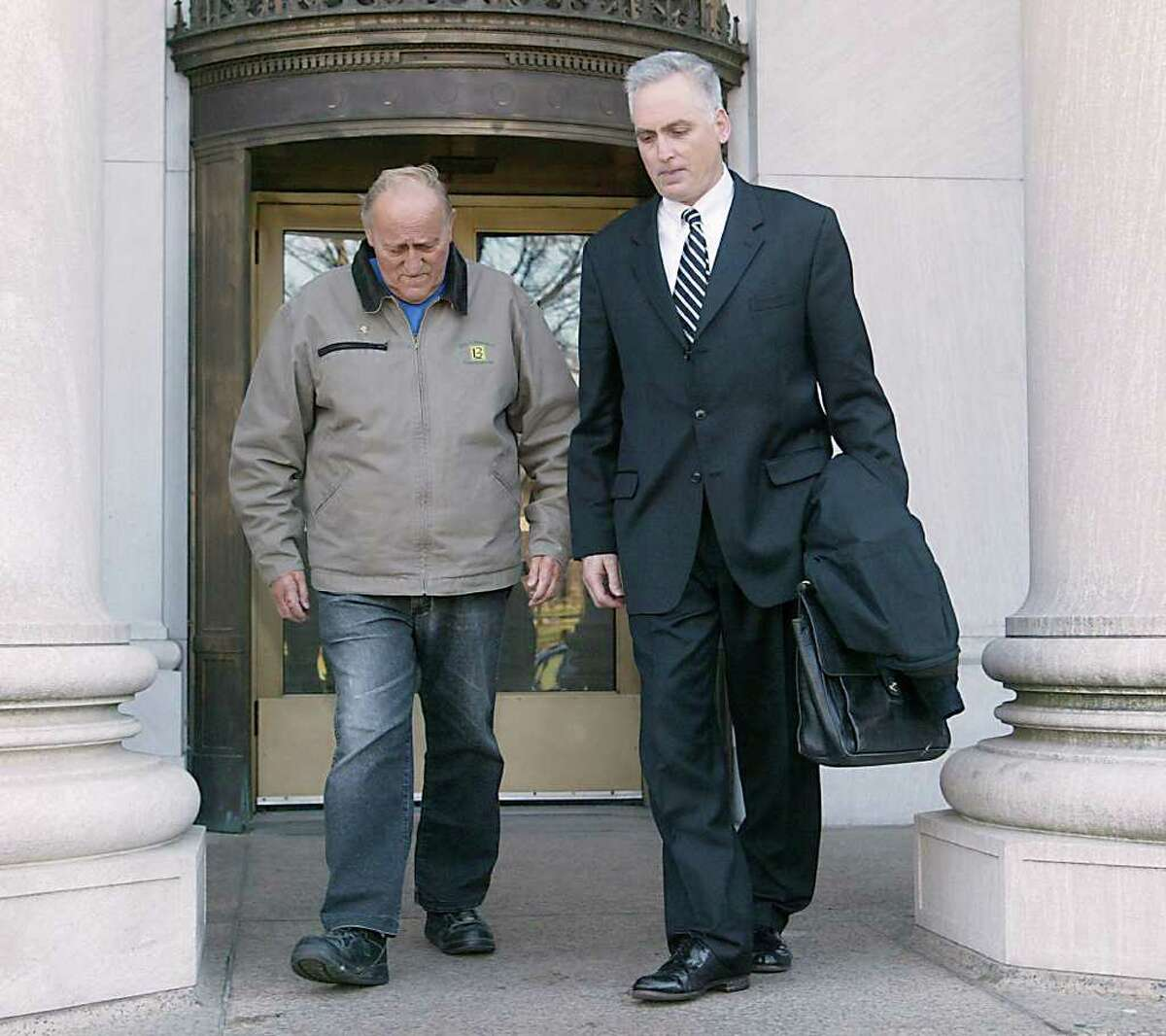 Peter Botti,Sr., father of James Botti, and his attorney Eugene Roccio leave the New Haven Federal Courthouse after being arraigned in Dec. 2008. Peter Botti will be sentenced Wednesday for his role in helping his son, Shelton developer James Botti, commit mail fraud and currency violations. Peter Botti is 83 years old and dying, but federal prosecutors are urging a federal judge to impose prison time and send a message discouraging family members who cover up crimes by loved ones.