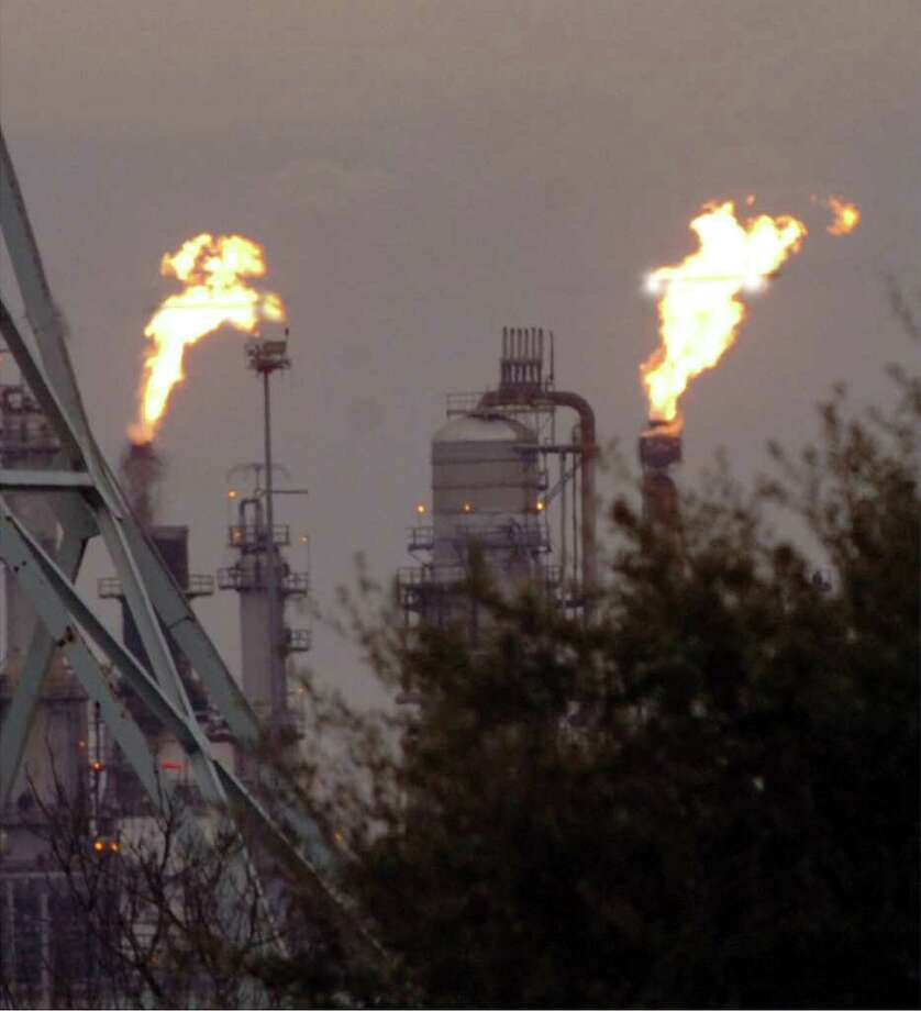 During the recent cold weather, several area petrochemical plants emitted various chemicals into the air via flaring and all are claiming an ìaffirmative defense,î which means they are blaming it on the freezing temperature. Pete Churton/The Enterprise Photo: Pete Churton