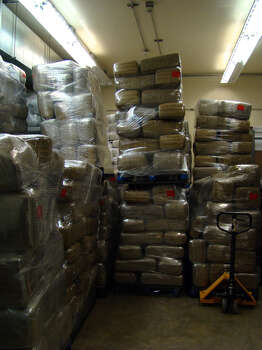 ICE agents discovered a total of 510 bricks of compressed marijuana with a combined weight of 13,314 pounds. In addition to the marijuana seized, ICE also discovered and seized three assault rifles and two shotguns. Photo: Courtesy