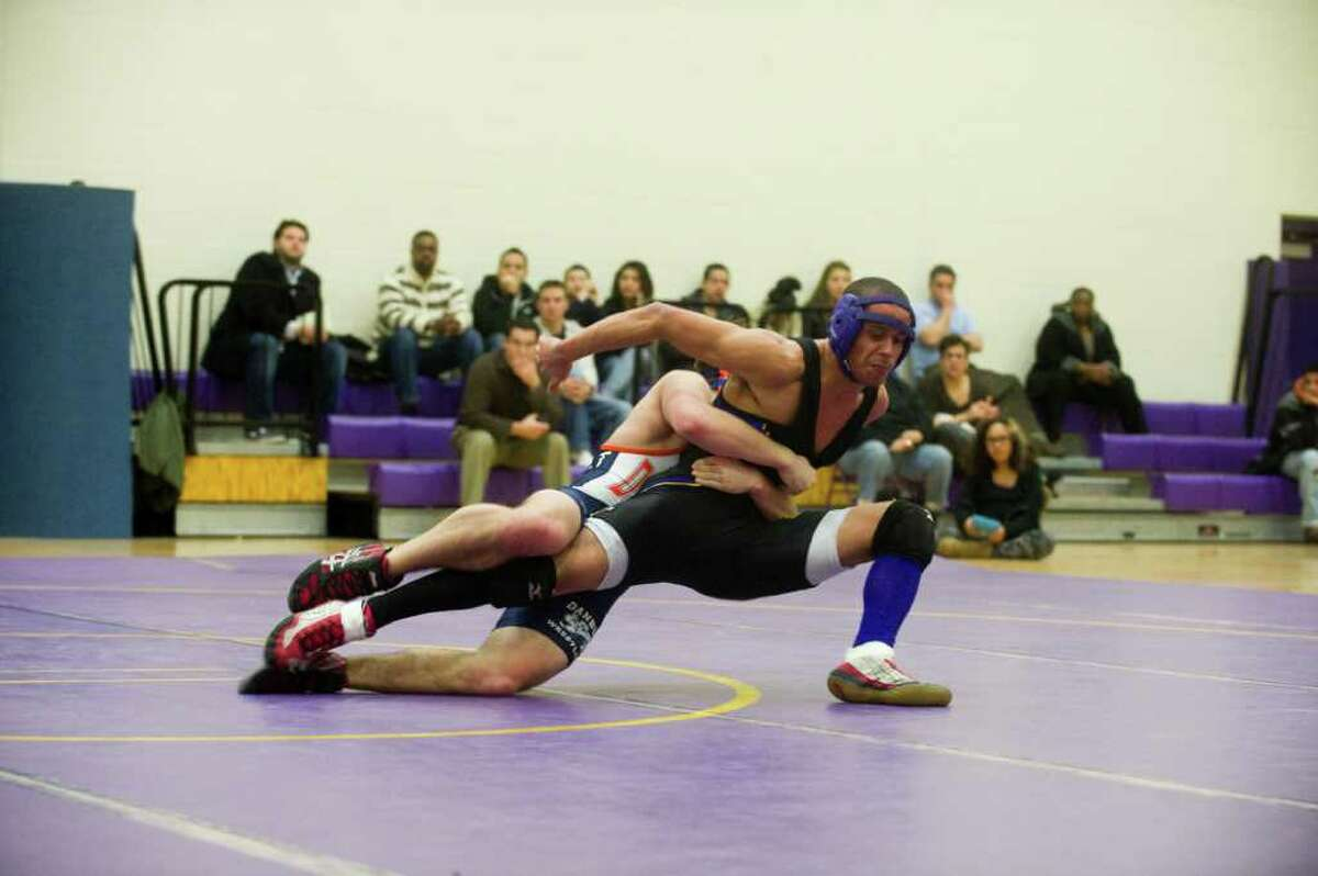 Westhill's Kevin Thomas and Danbury's Tyler Arsenault wrestle in the 140 pound division as Westhill High School hosts Danbury High in a boys wrestling match in Stamford, Conn., February 7, 2011. Thomas won the division.