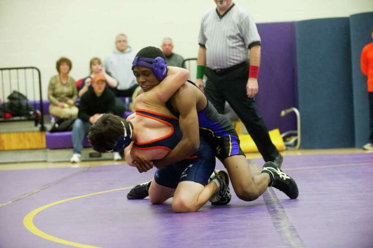Westhill's Armani Meandesir wrestles Danbury's Anthony Cote in the 135 pound division as Westhill High School hosts Danbury High in a boys wrestling match in Stamford, Conn., February 7, 2011. Meandesir won the division.