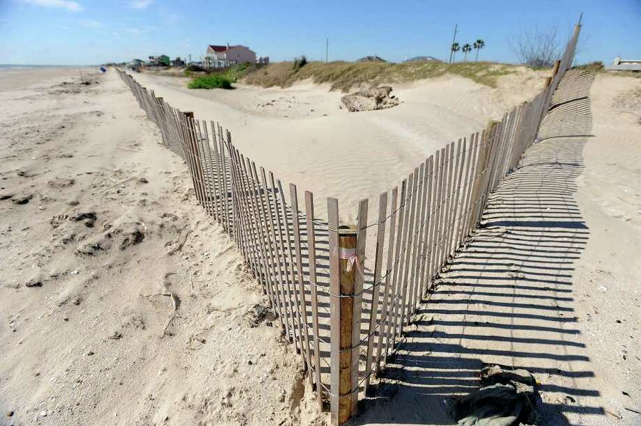 """A recent Texas Supreme Court opinion issued in a case involving a West Galveston beach property has set a precedent that could potentially undercut the way the Texas Open Beaches Act has been enforced for the past 50 years and could restrict beach access to the public. In the past, Texas coastal beaches were considered """"rolling easements"""" defined by the line of vegetation, but the court opinion called that unconstitutional in the case of major erosion events like Hurricane Ike.  Guiseppe Barranco/The Enterprise / Beaumont"""