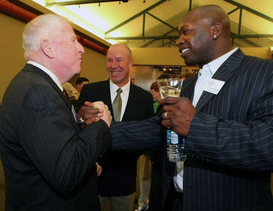 Former Minnesota Viking John Randle (right) is congratulated by former NFL referee Red Cashion (left) before Randle's induction in the 2010 Texas Sports Hall of Fame class on Monday, Feb. 7, 2011, in Waco. Photo: Associated Press, Jerry Larson/Waco Tribune Herald
