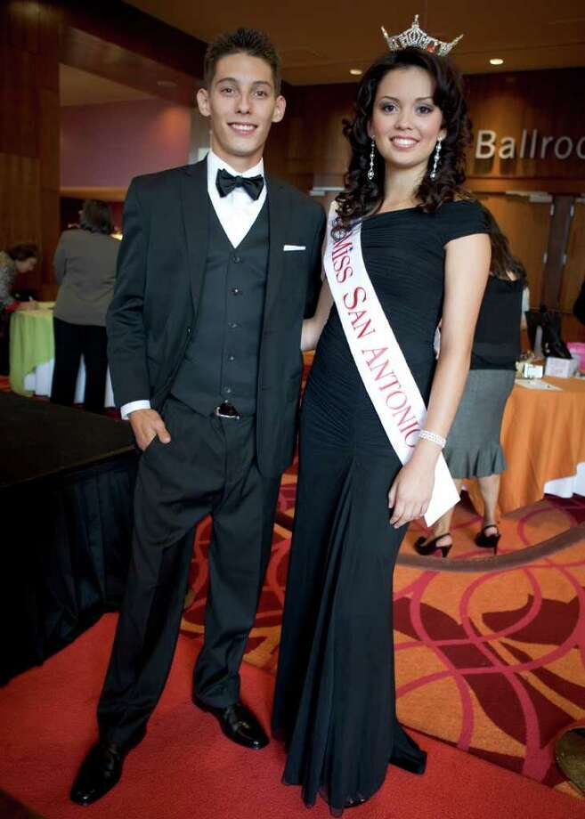TRENDS/HEIDBRINK Carlos Flores and 2011 Miss San Antonio Domonique Ramirez model fashions from Dillard's that were auctioned at the San Antonio Association of Hispanic Journalists 12th Annual Scholarship and Awards Gala at the Grand Hyatt San Antonio. Photo by Jamie Karutz. Photo: Jamie Couch Karutz, SPECIAL TO THE EXPRESS-NEWS / Copyright: Jamie Karutz All Rights Reserved