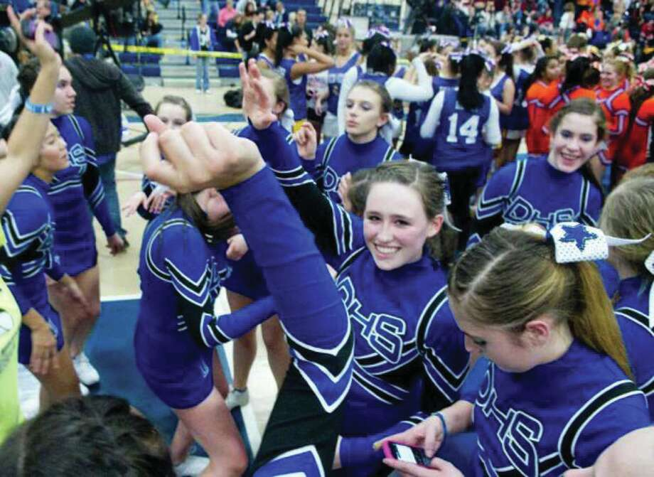 The Darien High School cheerleaders dance at the FCIAC Cheerleading Championships in Wilton Sunday. Photo: File Photo / Darien News