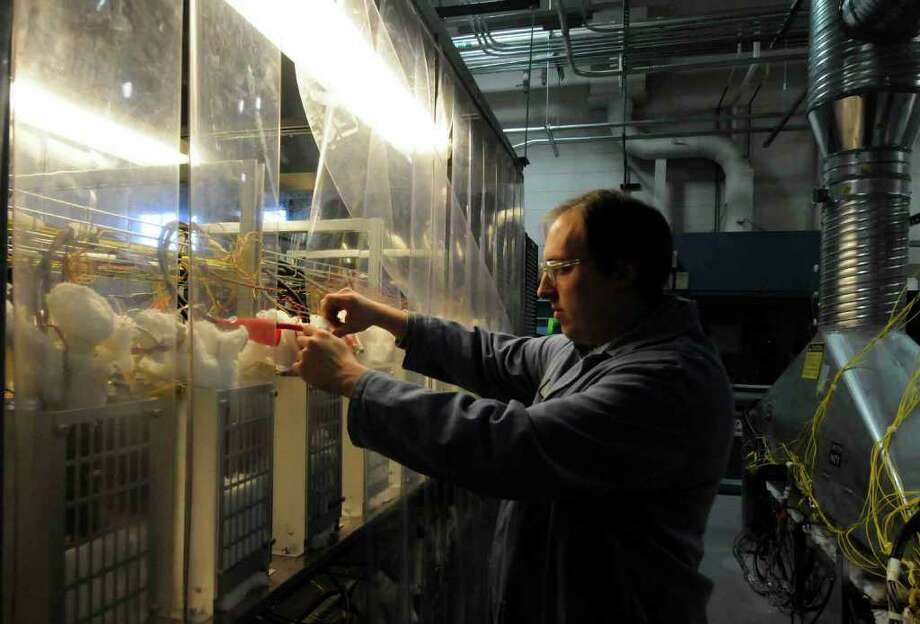Rich Church a scientist with GE Chemical Engineering Science works with batteries in the high-bay area for battery testing at the GE Global Research Center in Niskayuna Feb. 3, 2011.( Michael P. Farrell/Times Union ) Photo: Michael P. Farrell