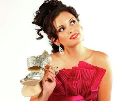 TRENDS/SA LIFE:  Miss San Antonio 2011, Domonique Ramirez, in holiday dresses.  HELEN L. MONTOYA/hmontoya@express-news.net Photo: HELEN L. MONTOYA