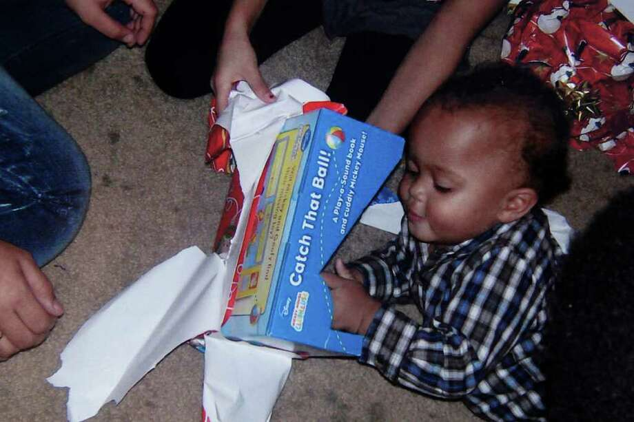 A photo of missing 18-month-old Joshua Davis, Jr. opening presents during the past Christmas in New Braunfels, in this handout photo provided by the family, Tuesday, Feb. 8, 2011. Photo: JERRY LARA, San Antonio Express-News / glara@express-news.net