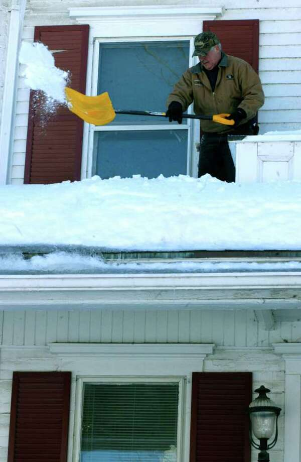 Don't wait for the first flakes to start preparing your home for winter.  Follow these tips provided by the Insurance Information Institute. Photo: Norm Cummings / The News-Times