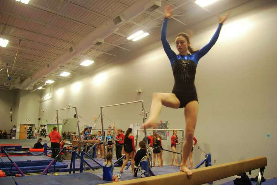 Fairfield Ludlowe's Dani Pasquerelli competes at the Falcons' meet against Warde and Staples on Saturday. Photo: Contributed Photo / Fairfield Citizen contributed