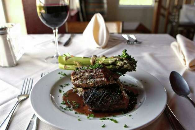 Rack of lamb is among Valentine's Day offerings at The Vineyards. Wine and rosesRestaurant: The Vineyards RestaurantAddress: 27315 FM 3009, 830-980-8033Hours: lunch: 11:30 a.m.-3 p.m. Friday-Sunday; dinner: 5-9 p.m. Sunday-Thursday; 5-10 p.m. Friday and SaturdayOn The Menu: